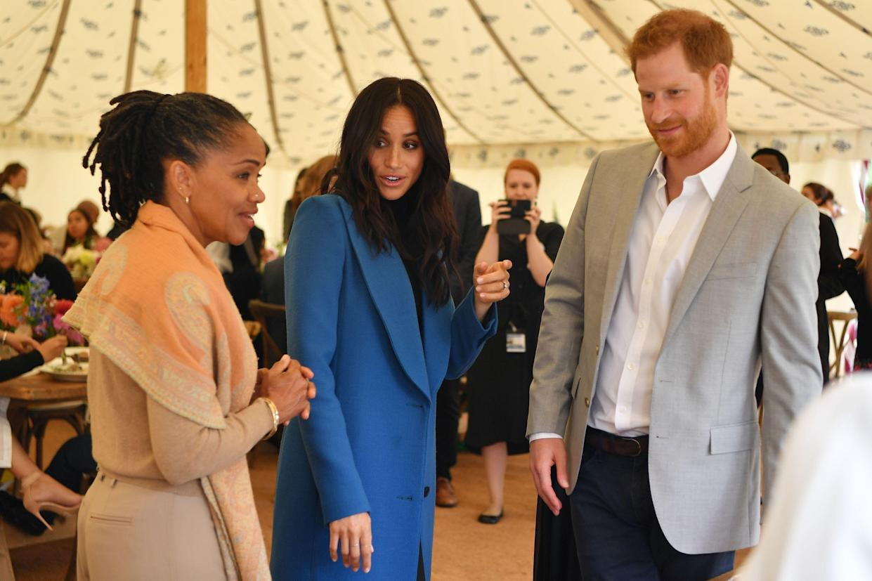 Doria with Harry and Meghan at the launch of the Hubb Community kitchen cookbook last September [Photo: PA]