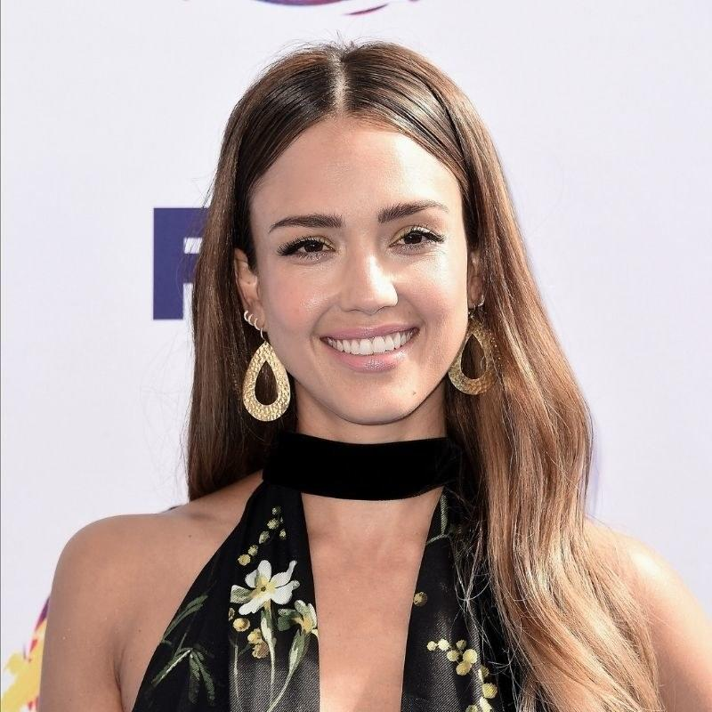 """Jessica Alba added beachy-blonde highlights to her medium-brown hair. These start low, past her ears, which can look more natural. To keep a shade like this from getting too warm, try using a <a href=""""https://www.allure.com/gallery/best-purple-shampoo-conditioner-blonde-hair?mbid=synd_yahoo_rss"""">purple shampoo</a> once or twice a week. It will flush out orange-red tones and keep it more neutral brown."""