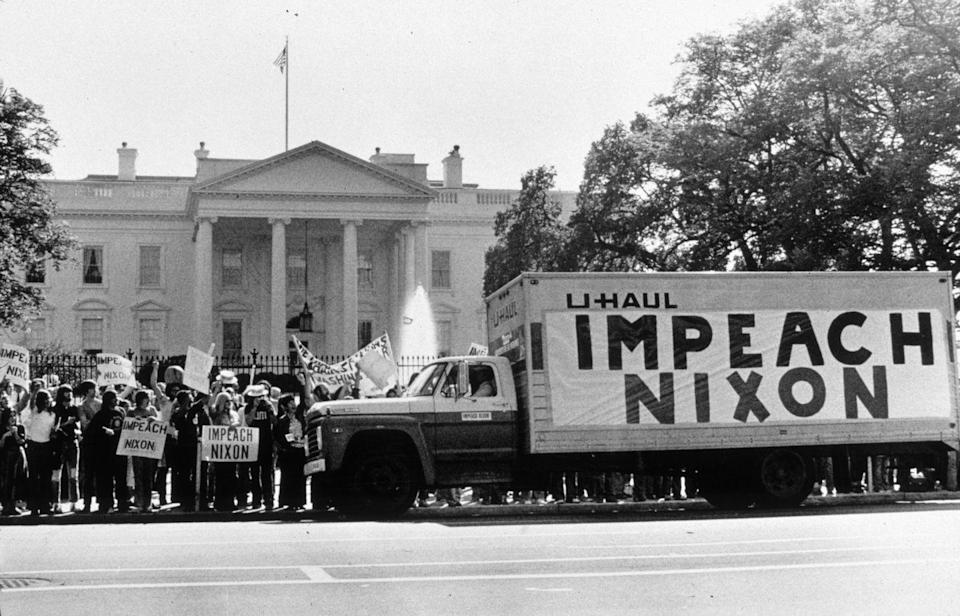 <p>After the Watergate scandal, where the Nixon administration covered up a failed break-in to the Democratic National Committee Headquarters, protestors advocated Nixon's impeachment and removal in front of the White House. Nixon resigned rather than await impeachment. </p>