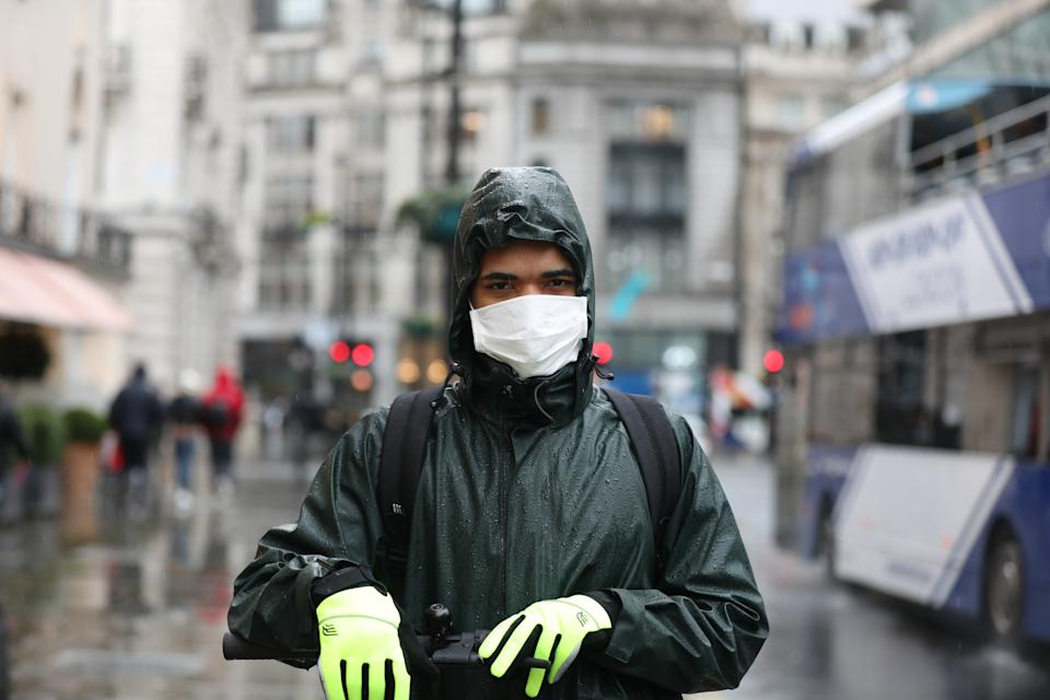 A man wears a face mask on Haymarket, London, as the first case of coronavirus has been confirmed in Wales and two more were identified in England - bringing the total number in the UK to 19. (Photo by Luciana Guerra/PA Images via Getty Images)