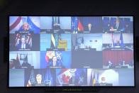 A screen displays NATO Foreign Ministers as they listen to NATO Secretary General Jens Stoltenberg during a video meeting following developments in Afghanistan at the NATO headquarters in Brussels, Friday, Aug. 20, 2021. (AP Photo/Francisco Seco, Pool)