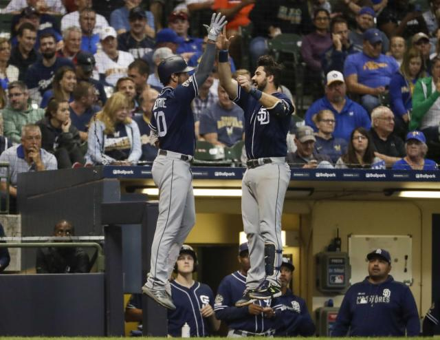 San Diego Padres' Hunter Renfroe celebrates his home run with teammate Austin Hedges during the seventh inning of a baseball game against the Milwaukee Brewers Tuesday, Sept. 17, 2019, in Milwaukee. (AP Photo/Morry Gash)
