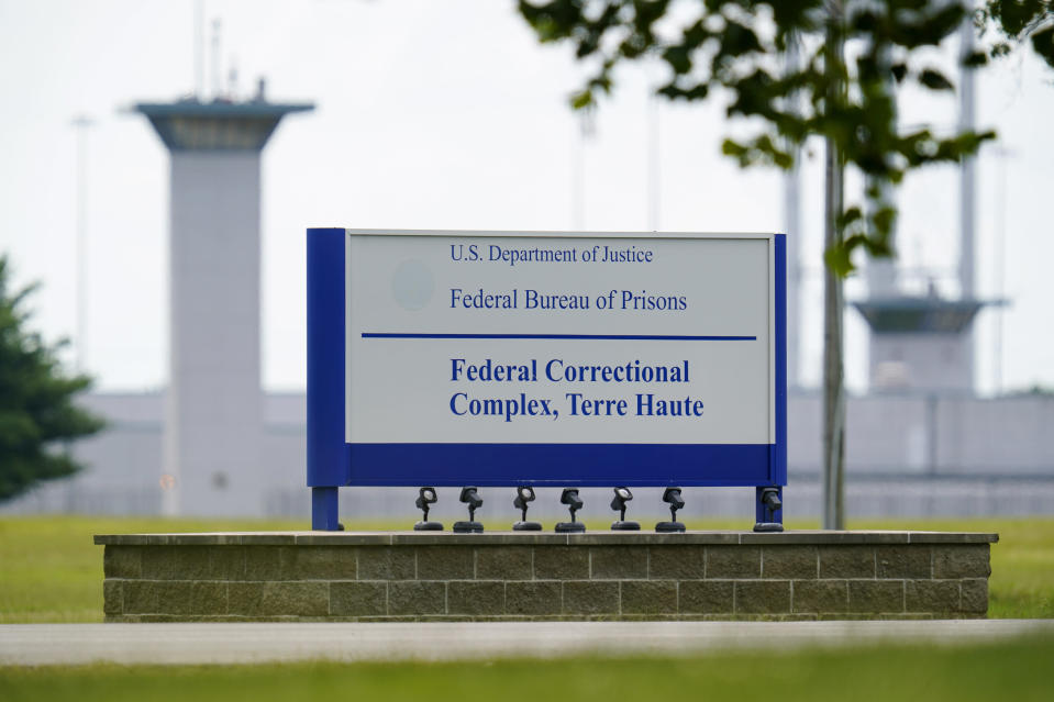 FILE - This Aug. 28, 2020, file photo shows the federal prison complex in Terre Haute, Ind. The Justice Department has scheduled three more federal executions during the lame-duck period before President-elect Joe Biden takes office, including two just days before his inauguration. In a court filing Friday night, Nov. 20, 2020 the Justice Department said it was scheduling the executions of Alfred Bourgeois for Dec. 11 and Cory Johnson and Dustin Higgs for Jan. 14 and 15. (AP Photo/Michael Conroy, File)