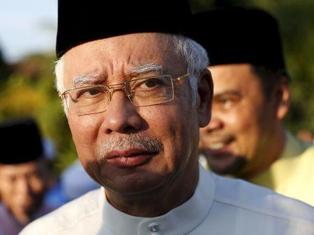 File photo of Malaysia's Prime Minister Najib Razak arriving for a news conference at a mosque outside Kuala Lumpur