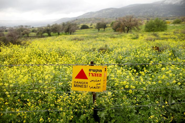 A sign warning of landmines is seen on a fence in the Golan Heights, the territory that Israel captured from Syria and occupied in the 1967 Six Day War, Feb. 27, 2019. Many Israeli and foreign tourists drive past on their way to popular holiday spots. (Photo: Ronen Zvulun/Reuters)
