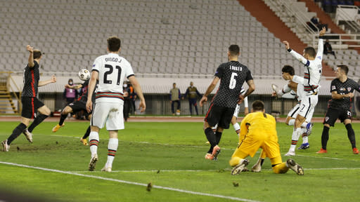 Portugal's Joao Felix, 3rd right, scores his side's second goal during the UEFA Nations League soccer match between Croatia and Portugal at the Poljud stadium in Split, Croatia, Tuesday, Nov. 17, 2020. (AP Photo/Darko Bandic)