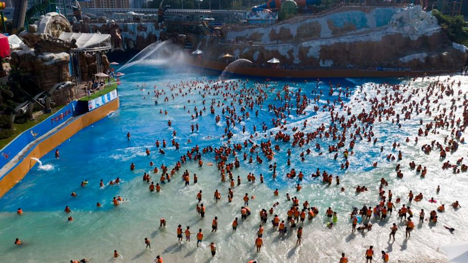 Tourists play in a water park to escape the heat, in Guiyang City on Thursday. Source: Getty