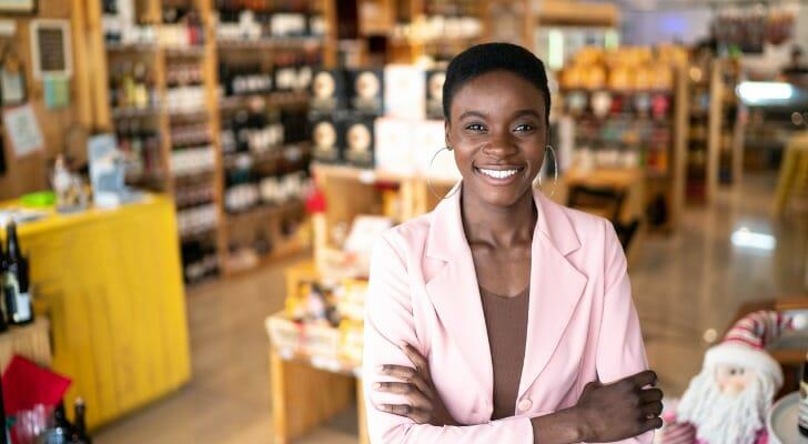 Owner of a liquor store standing inside her business