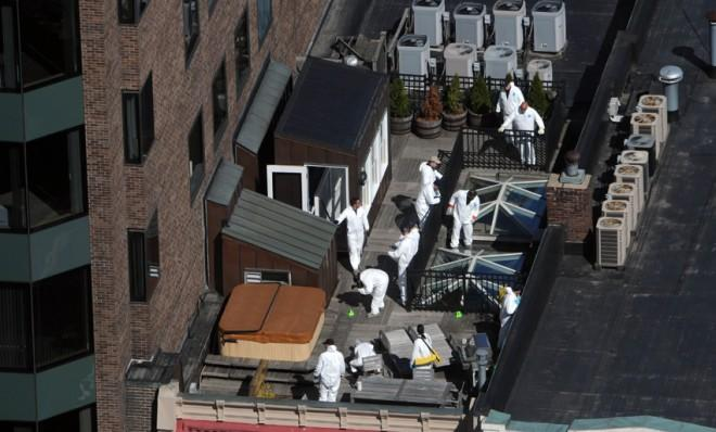 Crime scene investigators inspect a rooftop on April 18, above the site of the bombing on Boylston Street.