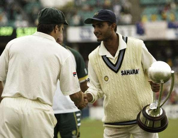 SYDNEY, AUSTRALIA - JANUARY 6: Steve Waugh of Australia who is retiring from Test Cricket shakes hands with Indian captain Sourav Ganguly who is holding the Border Gavaskar Trophy after day five of the 4th Test between Australia and India at the SCG on January 6, 2004 in Sydney, Australia. (Photo by Hamish Blair/Getty Images)