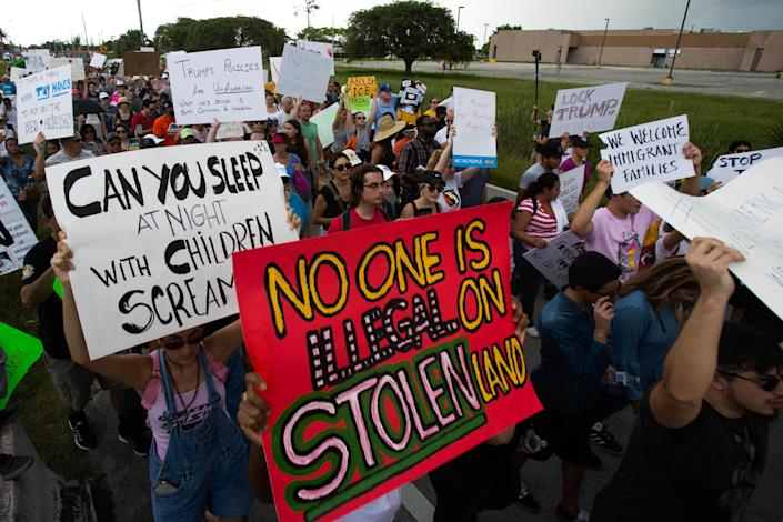 """<p>Demonstrators gather and hold signs during the """"Keep Families Together"""" rally outside of the Homestead temporary shelter for unaccompanied migrant children in Homestead, Fla., on Saturday, June 23, 2018. (Photo: Saul Martinez/Bloomberg via Getty Images) </p>"""