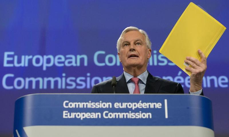 The EU's chief Brexit negotiator Michel Barnier holds a copy of the draft agreement with the UK as he addresses a media conference in Brussels on Wednesday.