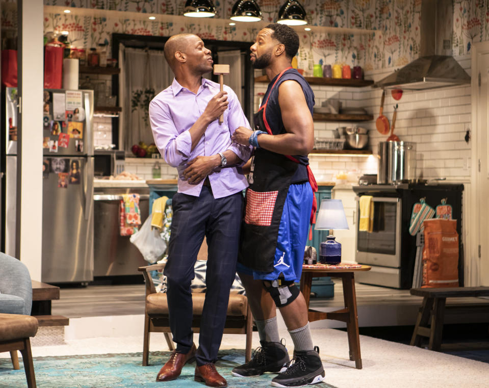"""Korey Jackson, left, and Toussaint Jeanlouis appear during a performance of """"The Hot Wing King."""" Playwright Katori Hall won the Pulitzer Prize for drama for her play. (Monique Carboni/Blake Zidell & Associates via AP)"""