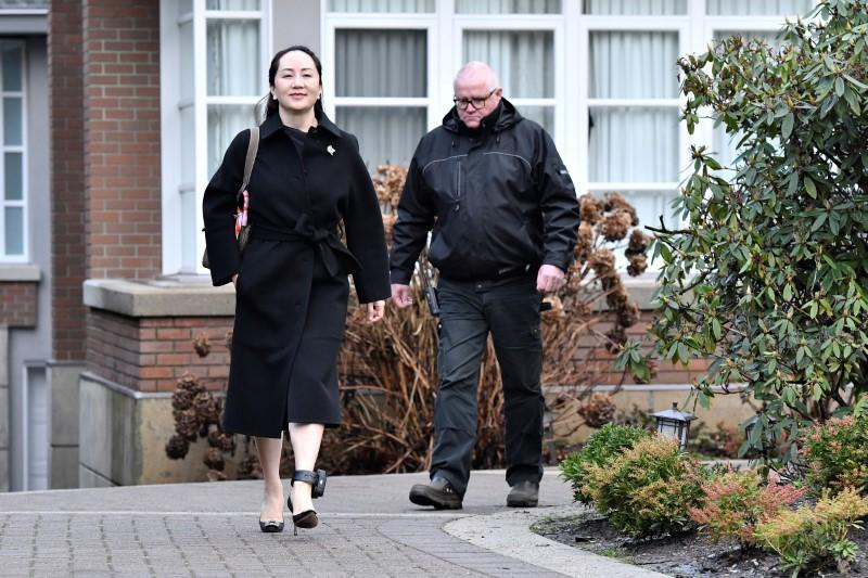 Huawei Chief Financial Officer Meng leaves her home to attend her extradition hearing in Vancouver