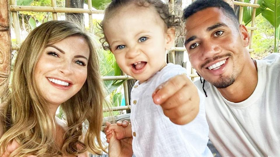 Pictured here, Roma defender Chris Smalling, his wife and young son.