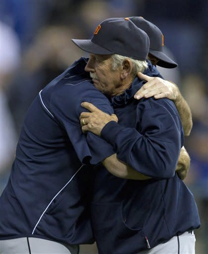 Detroit Tigers manager Jim Leyland, right, hugs a player following a baseball game against the Kansas City Royals at Kauffman Stadium in Kansas City, Mo., Monday, Oct. 1, 2012. The Tigers defeated the Royals 6-3 and clinched the AL Central title. (AP Photo/Orlin Wagner)