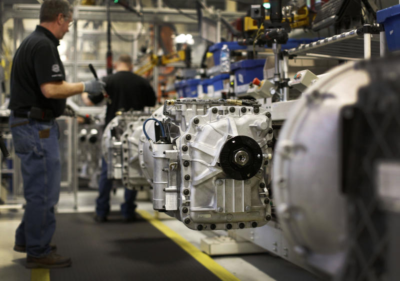 In this March 26, 2014 photo, workers build automated manual transmissions at Volvo Trucks' powertrain manufacturing facility in Hagerstown, Md. The Labor Department releases first-quarter productivity data on Wednesday, May 7, 2014. (AP Photo/Patrick Semansky)