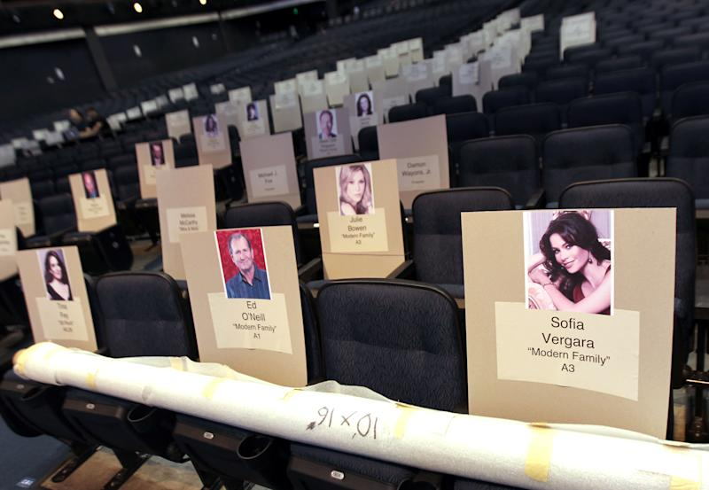 Seating placards for the 64thPrimetime Emmy Awards are seen at the Nokia Theatre on Wednesday, Sept. 19, 2012, in Los Angeles. The Emmy Awards will be held Sunday, Sept 23. (Photo by Matt Sayles/Invision/AP)