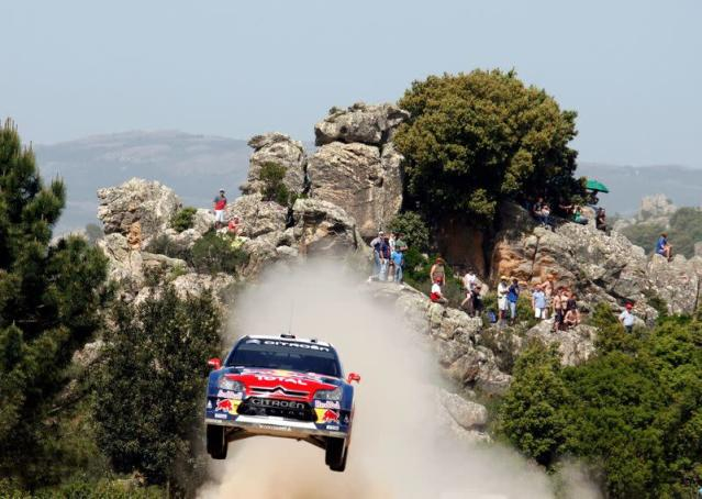FILE PHOTO: France's Sebastien Loeb goes airborne with his Citroen C4 during the Crastazza stage on the second day of the WRC Rally Italy in Sardinia