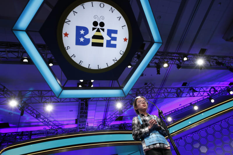 """<p> FILE - In this May 31, 2018 file photo, Lauren Guo, 12, from Arvada, Colo., competes in the Scripps National Spelling Bee in Oxon Hill, Md. An unremarkable sound can be the toughest thing for spellers to master at the Scripps National Spelling Bee. It's known as the schwa. It sounds like """"Uh,"""" and any vowel can make the sound. Spellers have a variety of techniques to figure out unfamiliar schwas, but none of the strategies is foolproof, and sometimes the only things to do are to memorize the word or guess. (AP Photo/Jacquelyn Martin, File) </p>"""