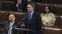 In this image from video, Rep. Thomas Massie, R-Ky., speaks on the floor of the House of Representatives at the U.S. Capitol in Washington, Friday, March 27, 2020. (House Television via AP)