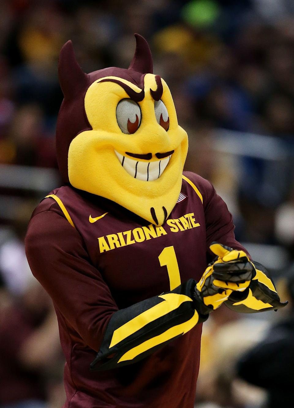 MILWAUKEE, WI - MARCH 20:  Arizona State Sun Devils mascot Sparky looks on in the second half against the Texas Longhorns during the second round of the 2014 NCAA Men's Basketball Tournament at BMO Harris Bradley Center on March 20, 2014 in Milwaukee, Wisconsin.  (Photo by Jonathan Daniel/Getty Images)