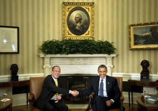 <p>US President Barack Obama (R) and President of the Philippines Benigno Aquino shake hands after a meeting in Washington, DC. The United States and the Philippines called for freedom of navigation in the tense South China Sea as the White House offered a robust show of support for President Benigno Aquino.</p>