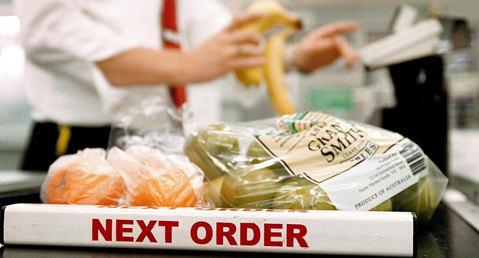 A Woolworths supermarket checkout with 'next order' sign on 24 August 2004.