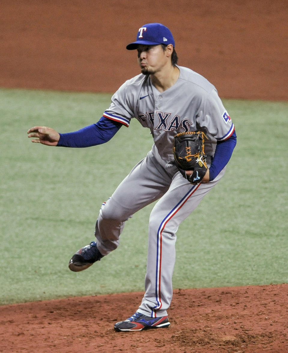 Texas Rangers starter Kohei Arihara watches a throw to a Tampa Bay Rays batter during the fourth inning of a baseball game Wednesday, April 14, 2021, in St. Petersburg, Fla. (AP Photo/Steve Nesius)