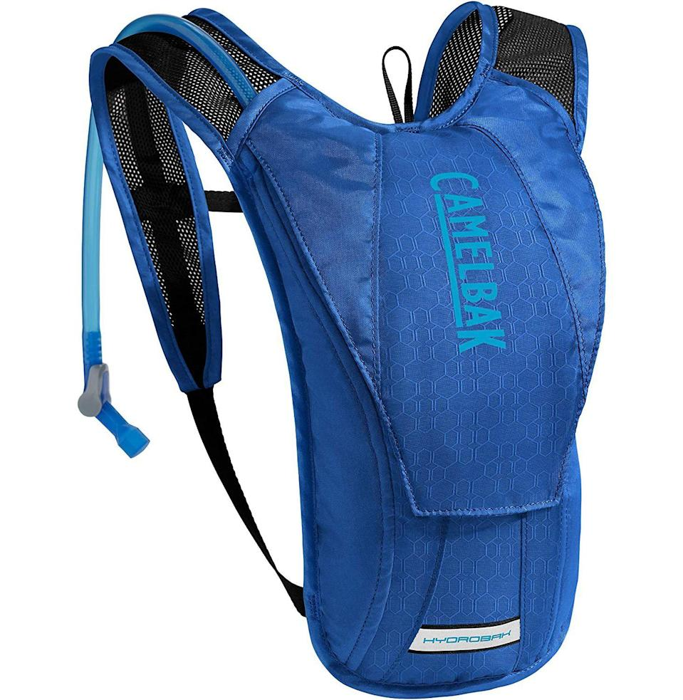 """<p><strong>CamelBak</strong></p><p>amazon.com</p><p><strong>$50.00</strong></p><p><a href=""""https://www.amazon.com/dp/B07HJQVH6K?tag=syn-yahoo-20&ascsubtag=%5Bartid%7C10054.g.37069847%5Bsrc%7Cyahoo-us"""" rel=""""nofollow noopener"""" target=""""_blank"""" data-ylk=""""slk:Buy"""" class=""""link rapid-noclick-resp"""">Buy</a></p><p>Water: essential, but also heavy as all hell. CamelBak's water-toting backpack distributes the weight best. It's as nerdy-cool as hiking gear comes.</p>"""