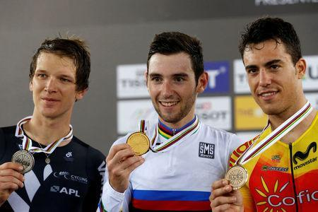 Cycling - UCI Track World Championships - Men's Omnium - Hong Kong, China – 15/4/17 - New Zealand's Aaron Gate, France's Benjamin Thomas, and Spain's Albert Torres celebrate with medals. REUTERS/Bobby Yip