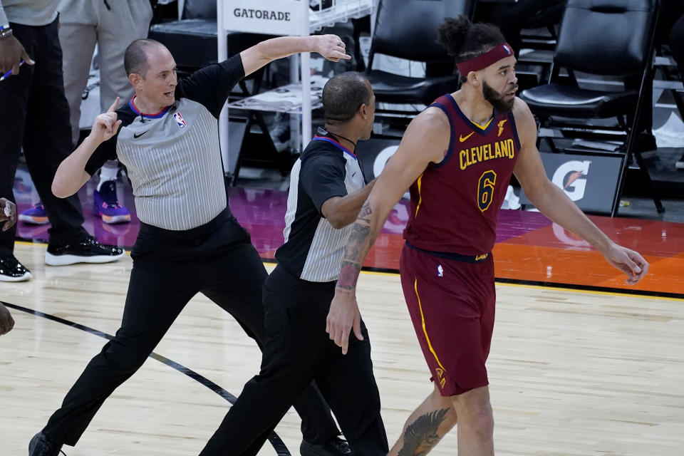Referee Marat Kogut ejects Cleveland Cavaliers center JaVale McGee (6) during the second half of an NBA basketball game against the Phoenix Suns, Monday, Feb. 8, 2021, in Phoenix. (AP Photo/Matt York)