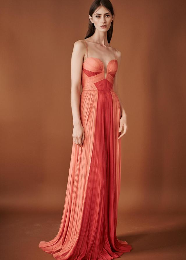 <p><i>Model wears a peach-and-red pleated dress from the SS18 J.Mendel collection. (Photo: ImaxTree) </i></p>