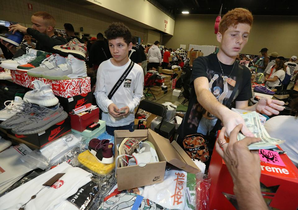 FT LAUDERDALE, FLORIDA - FEBRUARY 02: Kareem Kowatoli of Orlando (L) and Tarek Kowataoli purchase a pair of sneakers for $1470 to resell during SneakerCon 2019 at Fort Lauderdale Convention Center on February 2, 2019 in Fort Lauderdale, Florida. (Photo by Sean Drakes/Getty Images)