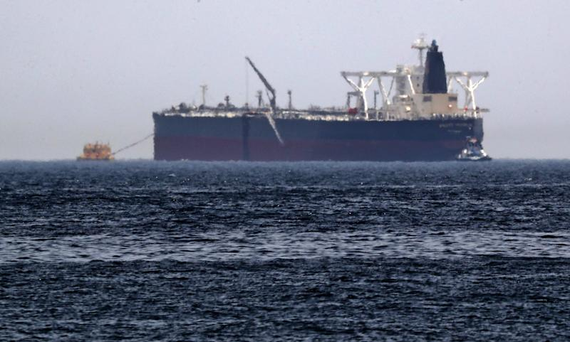 "A picture taken on May 13, 2019, shows the crude oil tanker, Amjad, which was one of two Saudi reported tankers that were damaged in mysterious ""sabotage attacks"", off the coast of the Gulf emirate of Fujairah. - Saudi Arabia said two of its oil tankers were damaged in mysterious ""sabotage attacks"" in the Gulf as tensions soared in a region already shaken by a standoff between the United States and Iran. (Photo by KARIM SAHIB / AFP) (Photo credit should read KARIM SAHIB/AFP/Getty Images)"