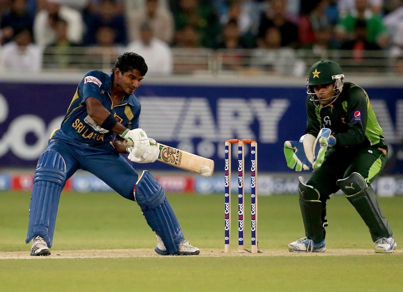 DUBAI, UNITED ARAB EMIRATES - DECEMBER 13:  Kusal Janith Perara of Sri Lanka bats during the second Twenty20 International match between Pakistan and Sri Lanka at Dubai Sports City Cricket Stadium on December 13, 2013 in Dubai, United Arab Emirates.  (Photo by Francois Nel/Getty Images)
