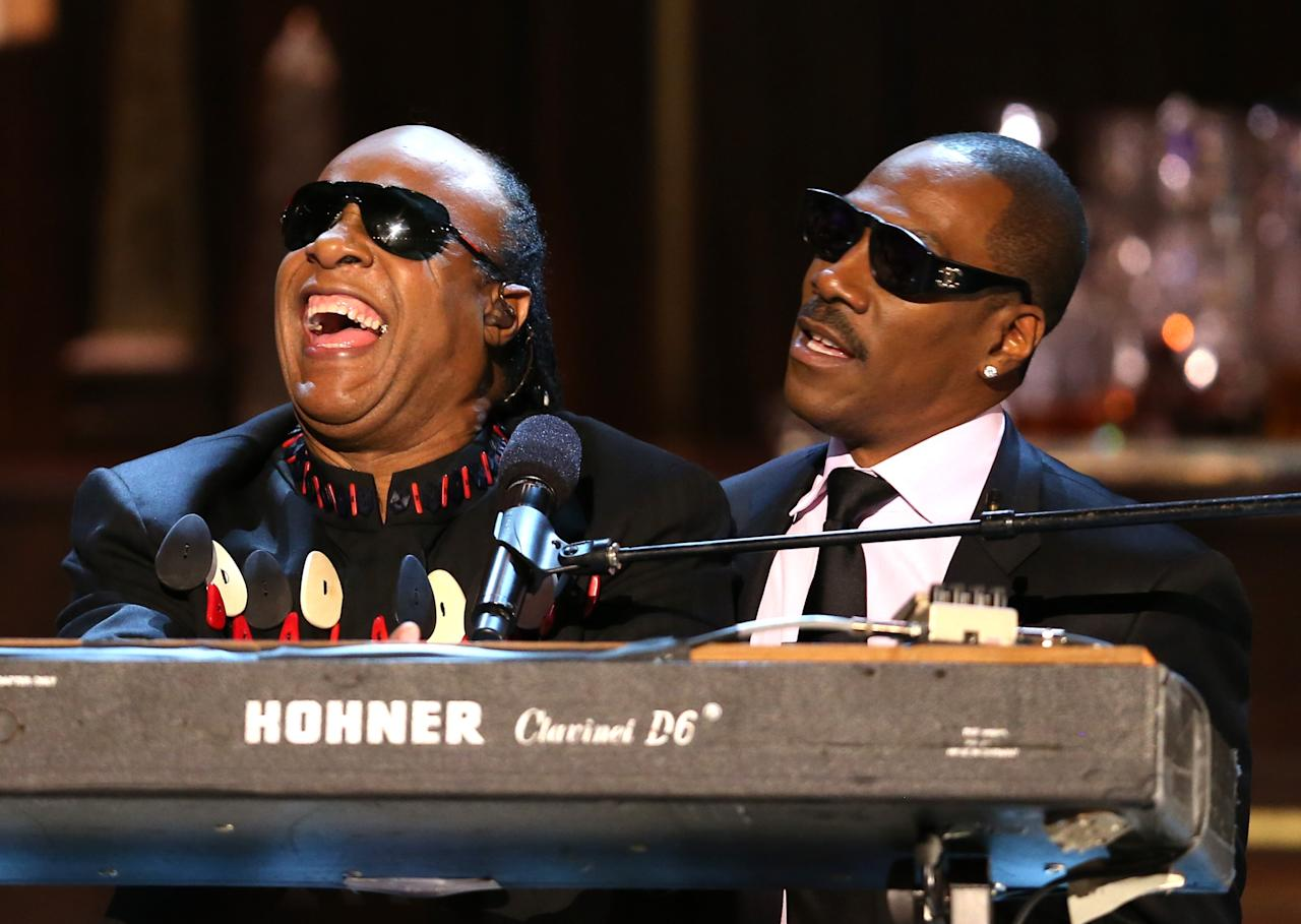 """BEVERLY HILLS, CA - NOVEMBER 03:  (L-R) Musician Stevie Wonder and honoree Eddie Murphy perform onstage at Spike TV's """"Eddie Murphy: One Night Only"""" at the Saban Theatre on November 3, 2012 in Beverly Hills, California.  (Photo by Christopher Polk/Getty Images)"""