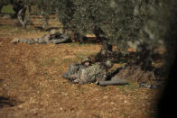 Turkish backed rebel fighters take positions near the village of Neirab in Idlib province, Syria, Thursday, Feb. 20, 2020. Two Turkish soldiers were killed Thursday by an airstrike in northwestern Syria, according to Turkey's Defense Ministry, following a large-scale attack by Ankara-backed opposition forces that targeted Syrian government troops. (AP Photo/Ghaith Alsayed)