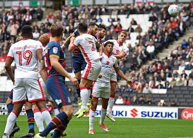 "Soccer Football - League One - Milton Keynes Dons vs Bradford City - Stadium MK, Milton Keynes, Britain - October 7, 2017 Bradford's Romain Vincelot scores their first goal Action Images/Alan Walter EDITORIAL USE ONLY. No use with unauthorized audio, video, data, fixture lists, club/league logos or ""live"" services. Online in-match use limited to 75 images, no video emulation. No use in betting, games or single club/league/player publications. Please contact your account representative for further details."