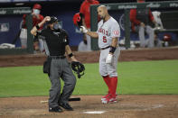 Los Angeles Angels' Albert Pujols (5) looks at home plate umpire Chris Guccione after he was called out on strikes looking to end the top of the eighth inning of the team's baseball game against the Seattle Mariners, Tuesday, Aug. 4, 2020, in Seattle. (AP Photo/Ted S. Warren)