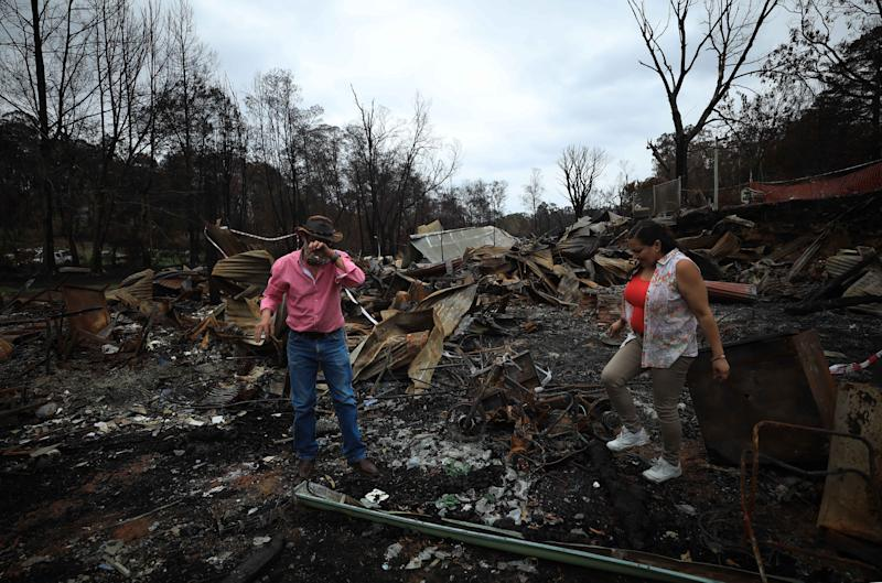 CANBERRA, Jan. 18, 2020 -- Photo taken on Jan. 18, 2020 shows a man shedding tears on the property ruins left by the bushfire in Mogo town, a two-hour drive from Canberra, Australia. At least 28 people have lost their lives and more than 2,000 homes been destroyed across the country in this bushfire season in Australia. (Photo by Chu Chen/Xinhua via Getty) (Xinhua/Chu Chen via Getty Images)