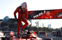 Ferrari driver Charles Leclerc of Monaco steps out of his car after taking pole position during the qualifying session at the Baku Formula One city circuit in Baku, Azerbaijan, Saturday, June 5, 2021. The Azerbaijan Formula One Grand Prix will take place on Sunday. (Maxim Shemetov, Pool via AP)