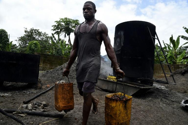 Nigeria's government is on a drive to revive the country's once thriving palm oil business (AFP/PIUS UTOMI EKPEI)