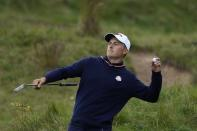 Team USA's Jordan Spieth throws a ball to a fan on the ninth hole during a practice day at the Ryder Cup at the Whistling Straits Golf Course Thursday, Sept. 23, 2021, in Sheboygan, Wis. (AP Photo/Ashley Landis)