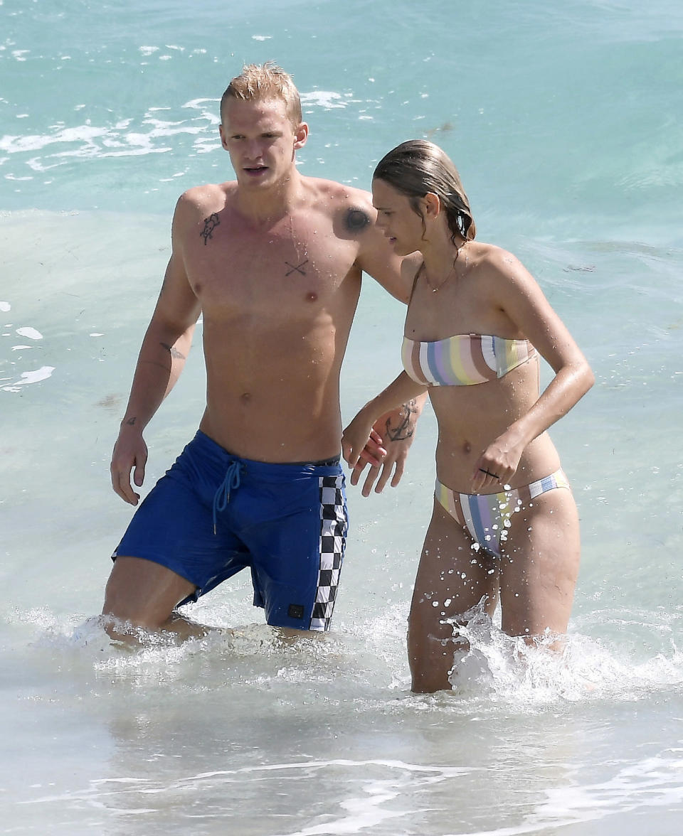 <p>Cody Simpson and girlfriend Marloes Stevens take a dip while vacationing in St. Bart's on Thursday. </p>