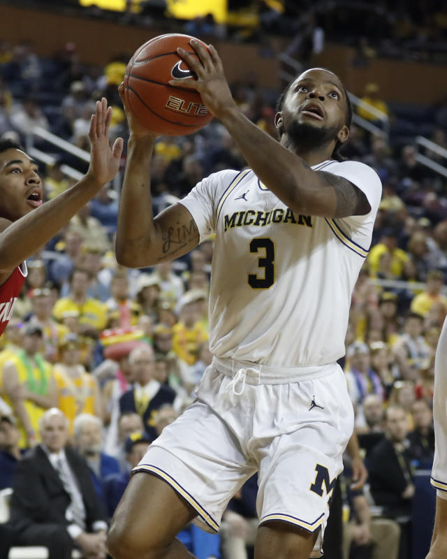 Michigan guard Zavier Simpson makes a layup during the second half of the team's NCAA college basketball game against Indiana, Sunday, Feb. 16, 2020, in Ann Arbor, Mich. (AP Photo/Carlos Osorio)