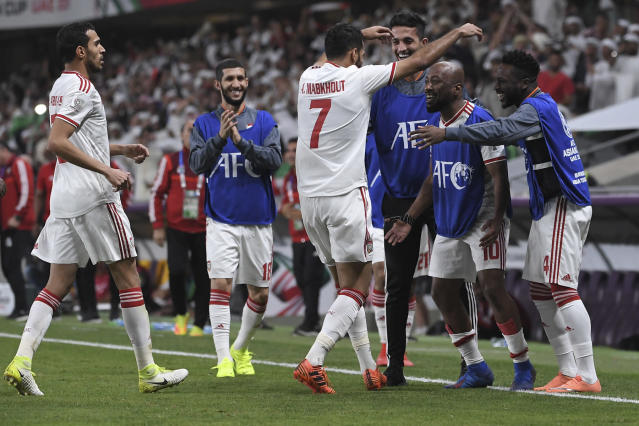 United Arab Emirates' players celebrate the goal during the AFC Asian Cup quarterfinal soccer match between United Arab Emirates and Australia at Hazza Bin Zayed Stadium in Al Ain, United Arab Emirates, Friday, Jan. 25, 2019. (AP Photo/Hassan Ammar)