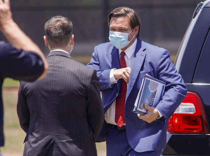 Gov. Ron DeSantis arrives May 8 at The Ballpark of the Palm Beaches in West Palm Beach for a news conference.