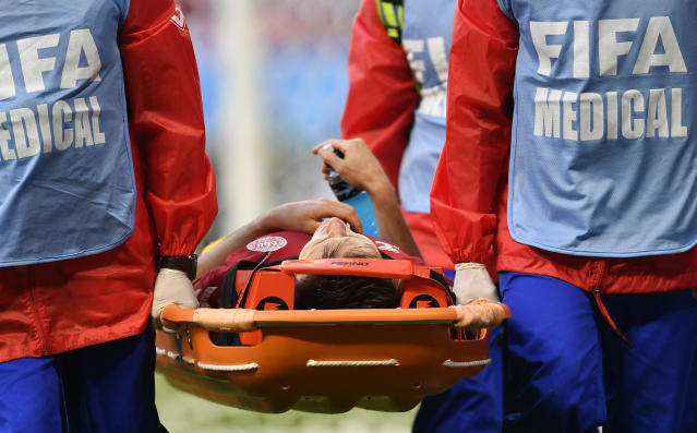Denmark's William Kvist leaves the field injured during the group C match between Peru and Denmark at the 2018 soccer World Cup in the Mordovia Arena in Saransk, Russia, Saturday, June 16, 2018. (AP Photo/Martin Meissner)