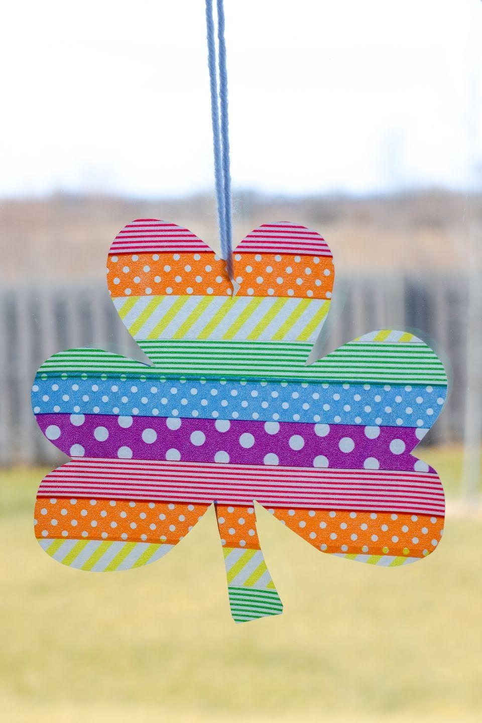 """<p>Remember all that washi tape you bought for the bullet journal you never used? Here's a clever way to finally use it. </p><p><em><a href=""""https://typicallysimple.com/washi-tape-shamrock-suncatcher/"""" rel=""""nofollow noopener"""" target=""""_blank"""" data-ylk=""""slk:Get the tutorial at Typically Simple »"""" class=""""link rapid-noclick-resp"""">Get the tutorial at Typically Simple » </a></em></p>"""